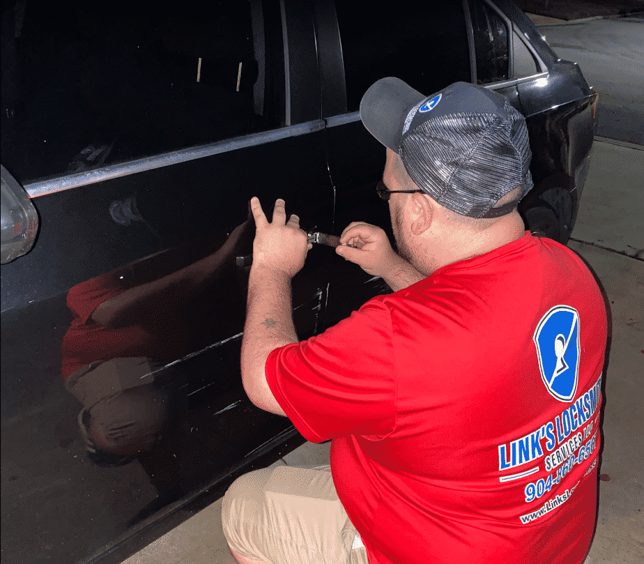 Owner, Jessie Link picking a car door lock for a client who lost their keys